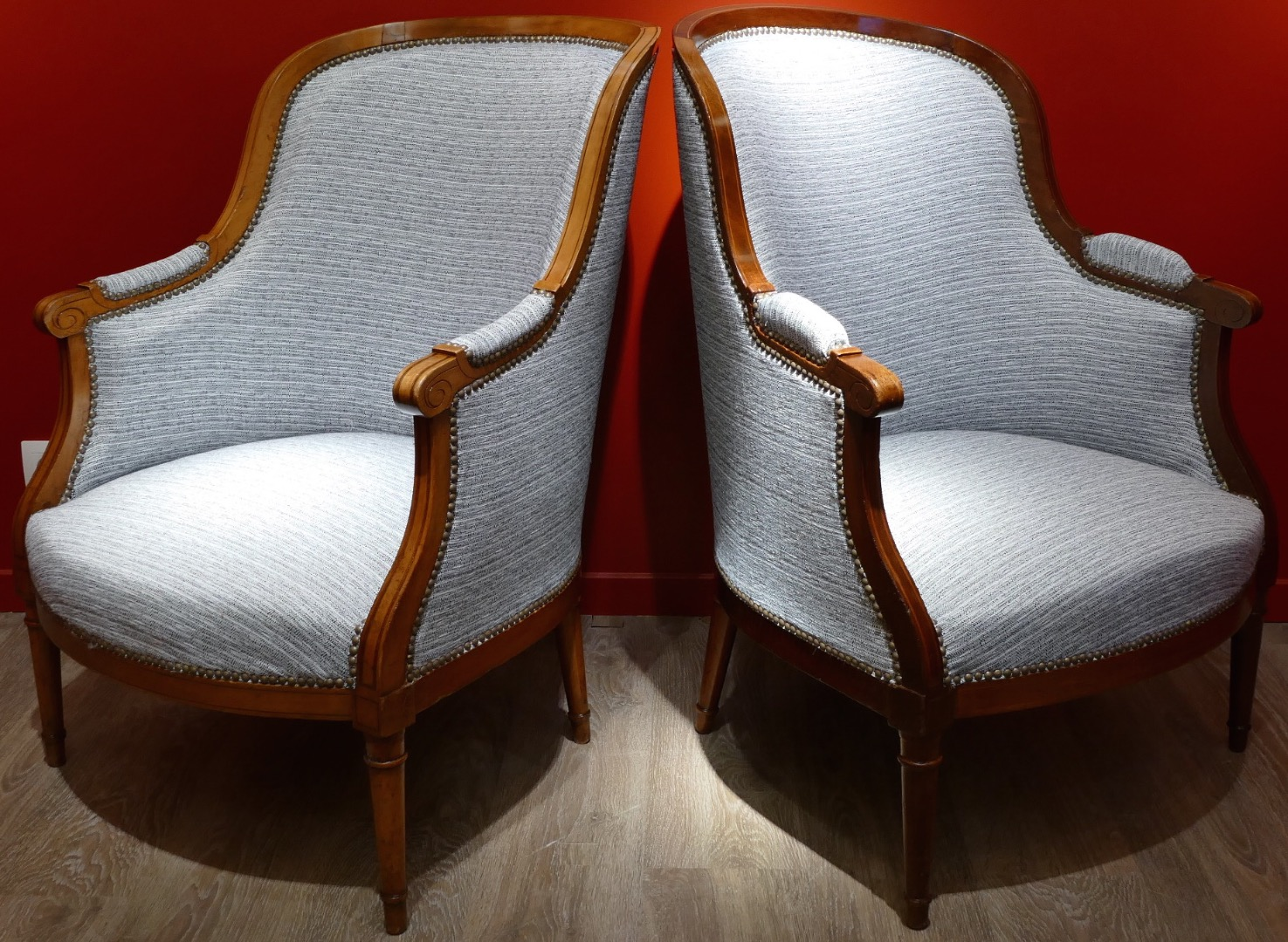 Pair of bergeres style Louis XVI in natural wood